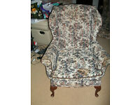 HIGH BACKED UPHOLSTERED CHAIR.