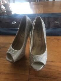 Size 4 Hollywood sparkly heels.