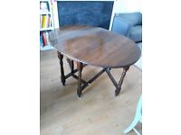 Solid dark wood drop leaf table.