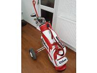 Golf clubs, golf trolley, golf bag.