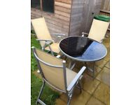 Glass top garden table and 3 chairs