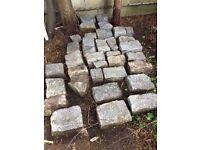 Granite stone setts, each one approx. 32cm x 22cm x 14cm, 26 in total