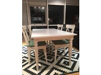 Dining white very clean table with 4 chairs