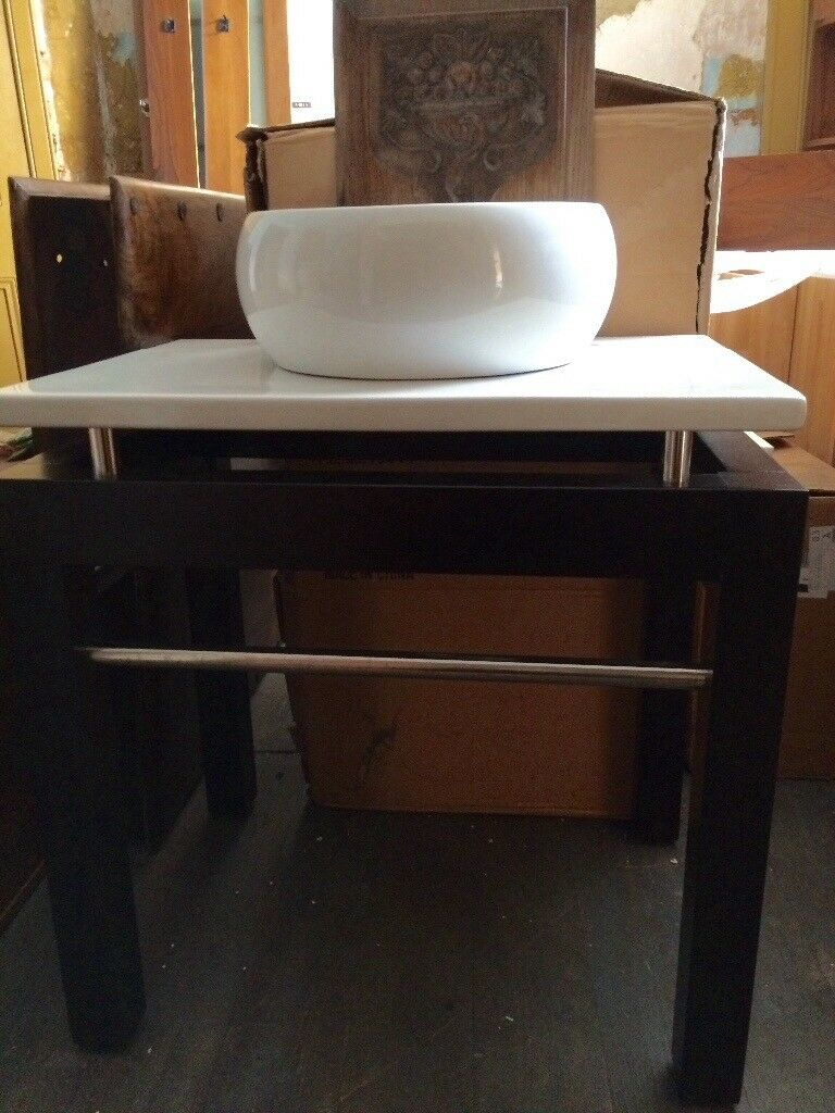 "Quality mahogany sink unit+ ceramic top+counter top basin. Chrome towel rails. 30""H x28""L. Unused"