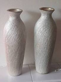 Pair of pale gold vases with matching candle holders