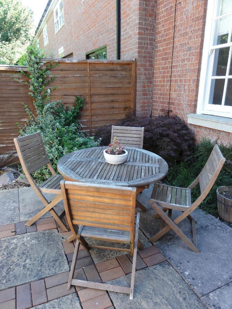 Round wooden garden table chairs seats 4 in market for Outdoor furniture gumtree