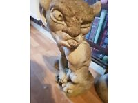 Two garden statues standing roughly 18 inches high..selling as moving to smaller premises
