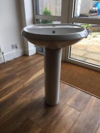 White bathroom sink pedestal