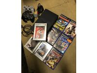 PlayStation 2 bundle with x2 controllers and 8 games