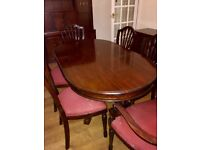 Solid Mahogany Dining Room table with 6 cushioned chairs (2 with arms). In very good condition.