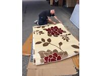 Large cream and red rug