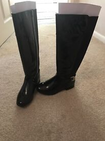 Knne high patent boots brand new