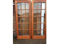 Pair of double solid wood glass paned rebated doors
