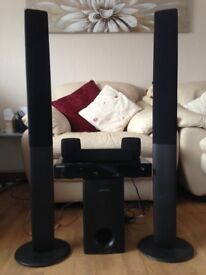 Samsung DVD stereo surround sound with sub woofer and tall speakers