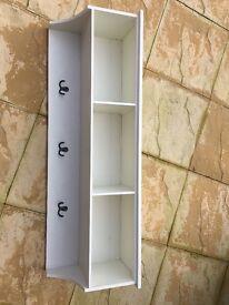 Large cream storage shelf with hooks