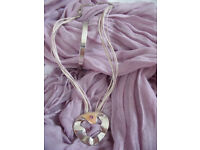 Silver tone metal bangle & unusual pendant on cord/chain, amethyst coloured stones. £3 ovno both