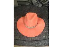 Orange felt floppy hat