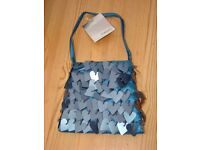 NEXT, brand new with tag. Zipped little evening bag with beaded hanging hearts. £3. Torquay, can pos