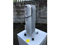 Description Medium sized white 7 fin oil filled fin oil filled radiator 1000w . £15