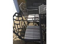 Cast Aluminium Table, 6 chairs, seat pads and parasol