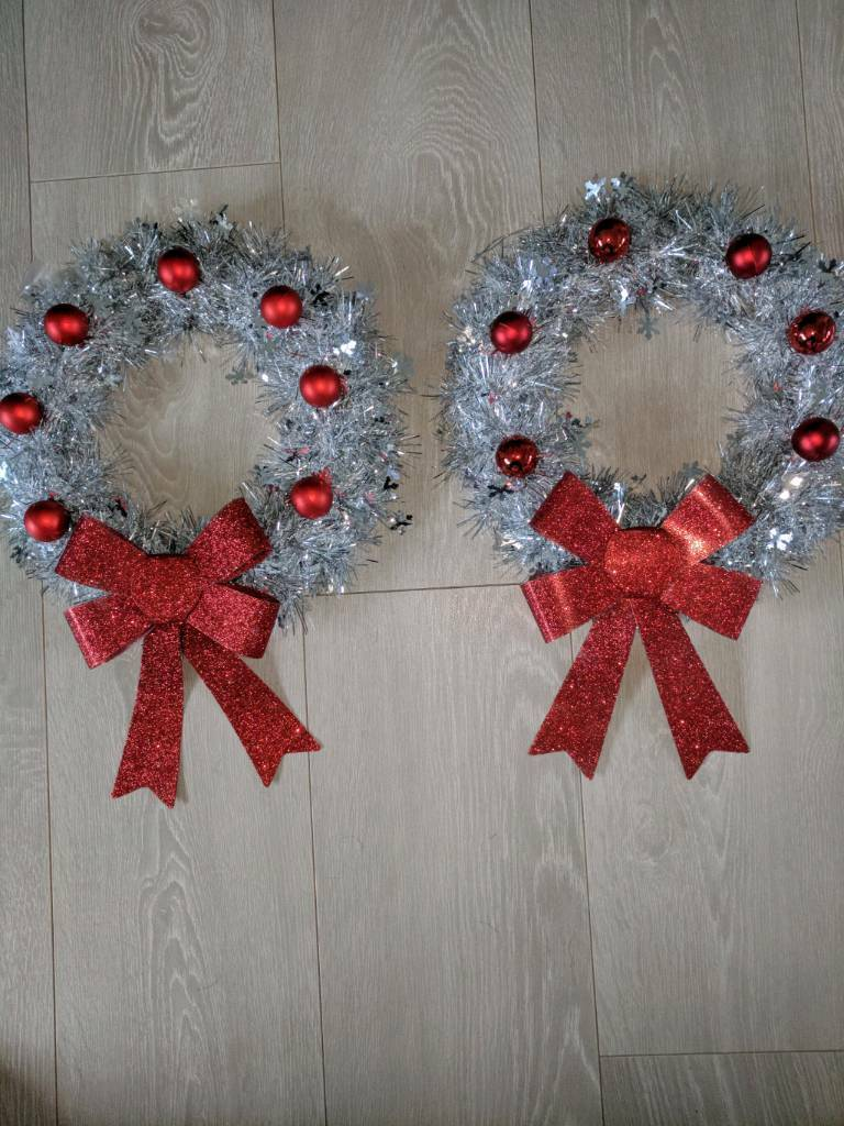 small silver wreath with lights,bow + baubles,gift wrapped