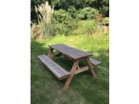 Solid wooden picnic bench
