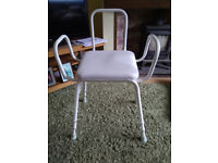 Perching stool-seat chair with arms and back rest