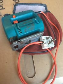 Black and Decker Electric Jigsaw (230v) with some blades.