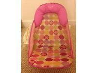 Babies pink bath seat