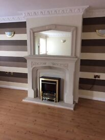 Fireplace with matching mirror and electric fire