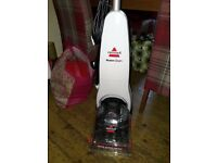 bissell carpet cleaner, as new condition, with full instructions, steam cleans carpets and rugs.