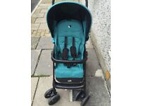 New Pushchair with cost toes and Rain cover By Joie