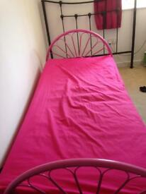 Pink metal framed single bed with very good, clean mattress