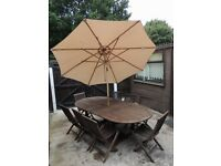 LARGE EXTENDING TABLE, 6 CHAIRS AND LARGE UMBRELLA*** FREE SUN LOUNGERS