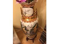 Chinese Porcelain Standing Pot with wooden lacquered stand.