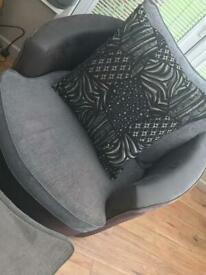 Swivel cuddle chair and footstool