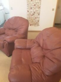 2 dark red leather armchairs