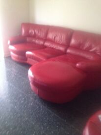RED LEATHER CORNER COUCH / 2 SEATER WITH SWIVEL CHAIR