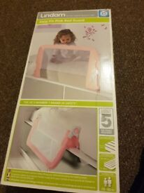 Lindam pink bed guard. Brand new in box