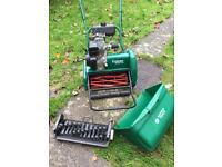 Qualcast Classic 17s Petrol Lawnmower and scarifier.