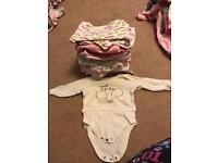 18 Long sleeve body suits size 6-9 months