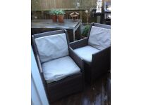 2 x cane effect dark brown chairs with weather proof seat and back cushions