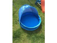 Baby paddling pool with movable sun shade