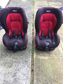 2 x Graco car seats - black & red. Good condition, no accidents.