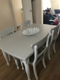 4 seater solid oak table and 4 chairs