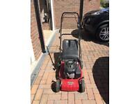 Mount field petrol lawnmower