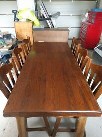 Solid oak refectory style dining room table with 6 matching chairs