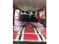Red VW T5 Van with smart bed and leather interior