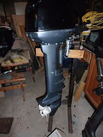 Yamaha 15 hp outboard with remote controls.