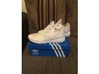 White adidas tubular running shoes